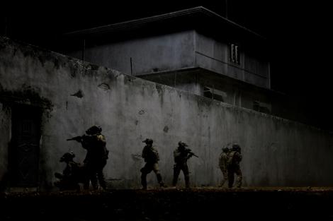 In the darkest hour of the night, elite Navy SEALs raid Osama bin Laden's compound in Zero Dark Thirty.