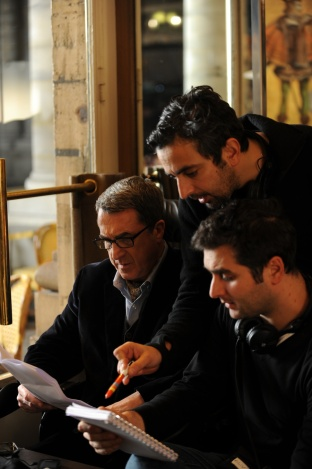 Writers and codirectors writer/directors Eric Toledano, center, and Olivier Nakache, right, on the set with François Cluzet