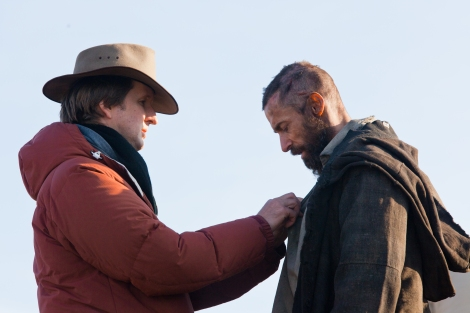 Director Tom Hooper, left, and Hugh Jackman on the set of Les Misérables.