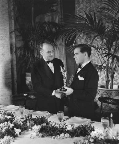 Harry Cohn, left, acceptor, Outstanding Production (YOU CAN'T TAKE IT WITH YOU), and Frank Capra, winner, Directing (YOU CAN'T TAKE IT WITH YOU) at the 1938 (11th) Academy Awards ceremony.
