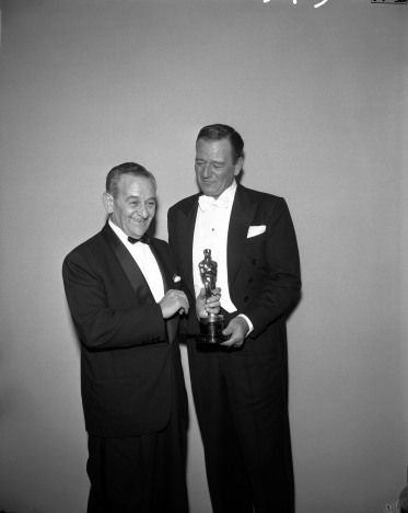 William Wyler and John Wayne backstage at the 1959 (32nd) Academy Awards ceremony.