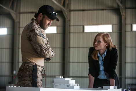 Joel Edgerton (left) plays a member of the Navy's elite SEAL Team Six and Jessica Chastain plays a member of the team of spies and military operatives who secretly devoted themselves to finding Osama Bin Laden in Columbia Pictures' electrifying new thriller directed by Kathryn Bigelow, ZERO DARK THIRTY.